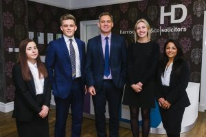 Harrison Drury's new trainees and executive chairman, John Chesworth.