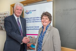 L-R Hugh Tomlinson, deputy CEO of Age UK South Lakeland and Jan Wright of Harrison Drury
