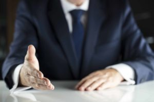 Employment tribunal with a man in a suit