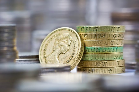 stack of pound coins financial legal advice