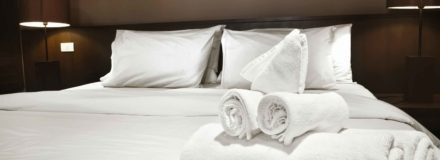 Hotel room with towels on a bed