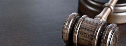 wooden gavel on desk