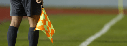 a linesman holding his flag